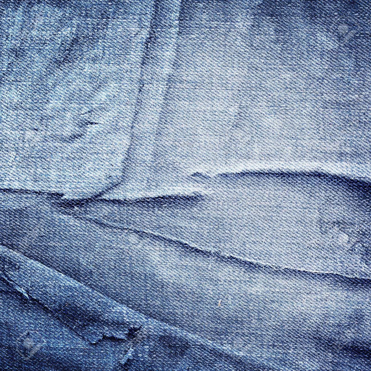 a42ca63a95d4 Abstract grunge jeans background with folds and scratches stock photo jpg  1300x1300 Abstract denim background
