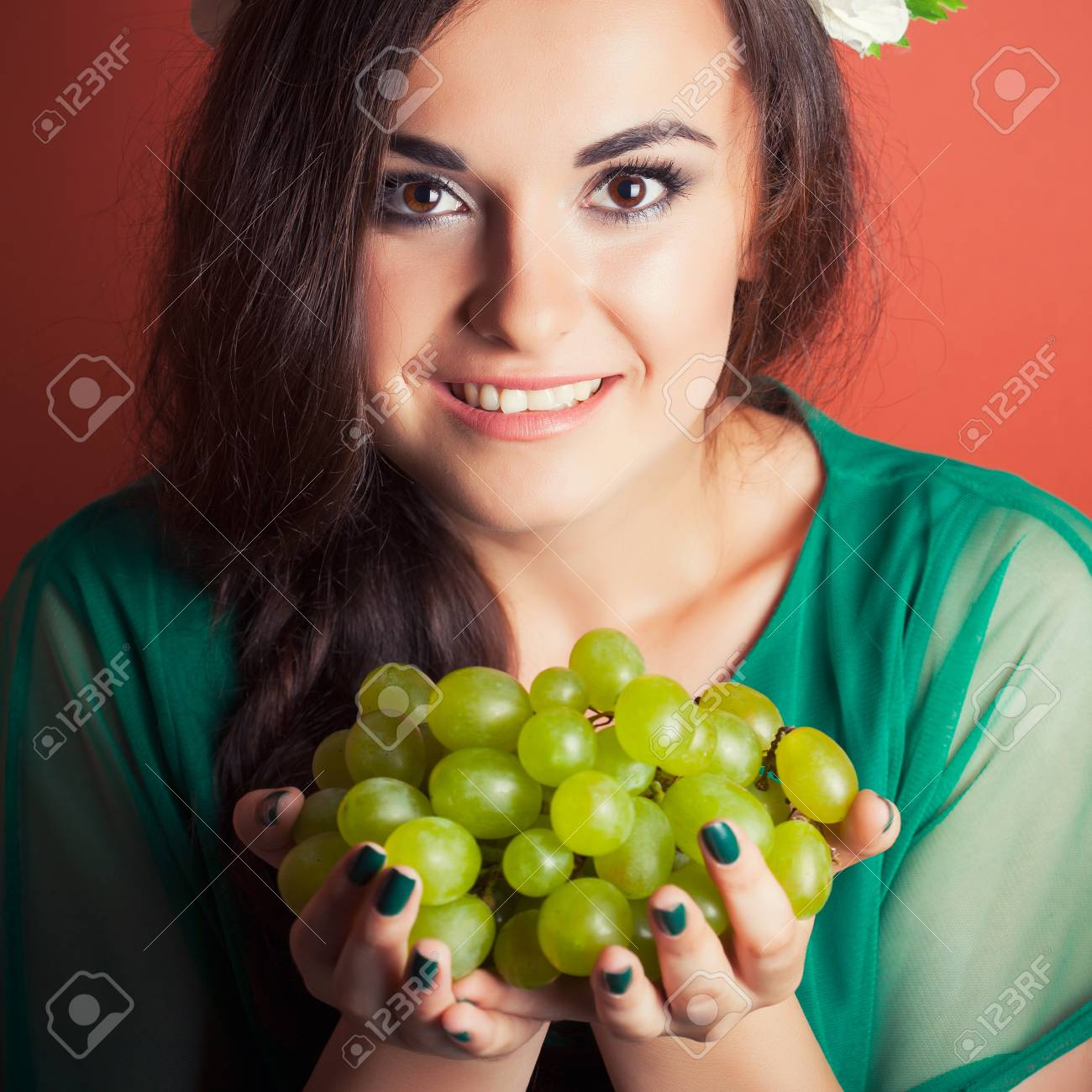 Beautiful Young Woman Wearing Wreath And Holding Green Grapes