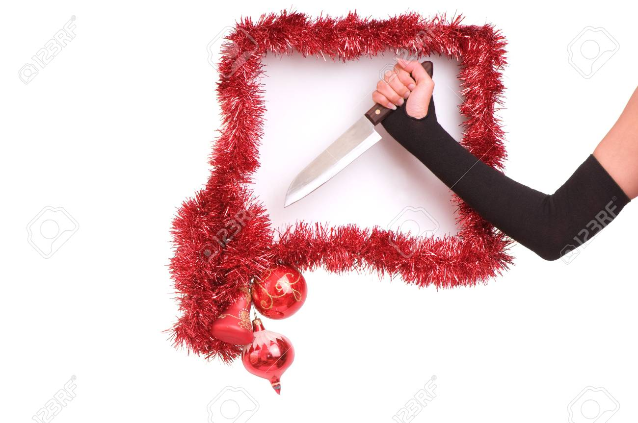 woman's hand with knife in the new-year frame Stock Photo - 5483069