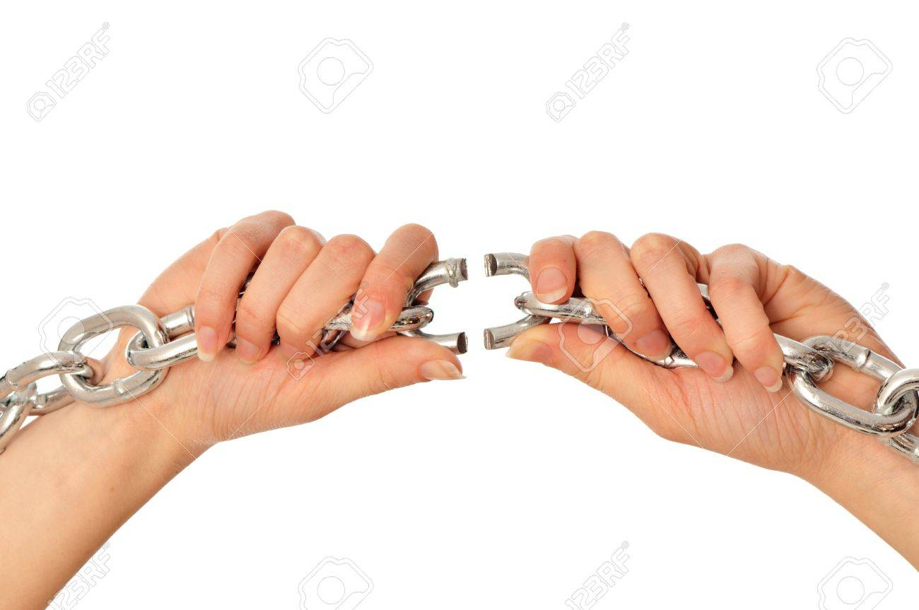 woman tearing a heavy chain by hands as a symbol of freedom Stock Photo - 8819056