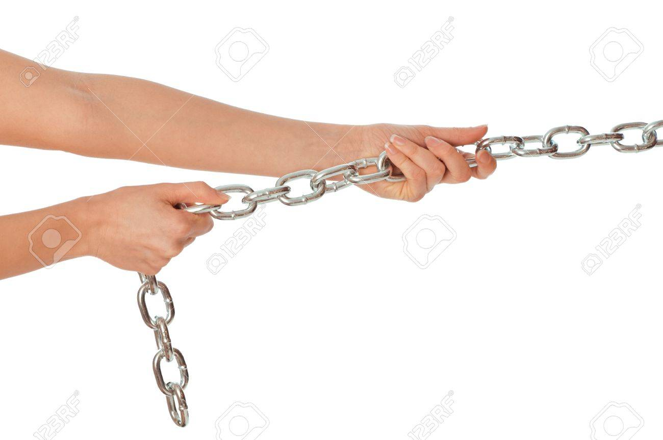 Woman pulling a long heavy metal chain Stock Photo - 8806902