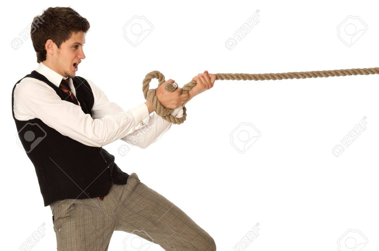 strong-willed man pulling of a rope and wins as a symbol of business success Stock Photo - 13324372