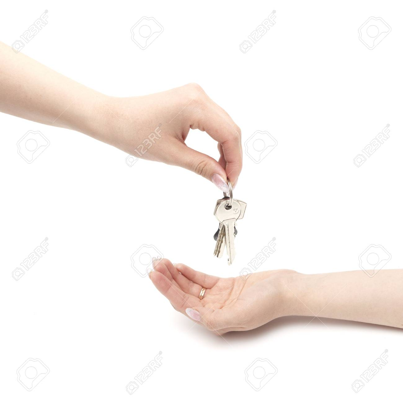 Hands and key isolated on white background Stock Photo - 6785219