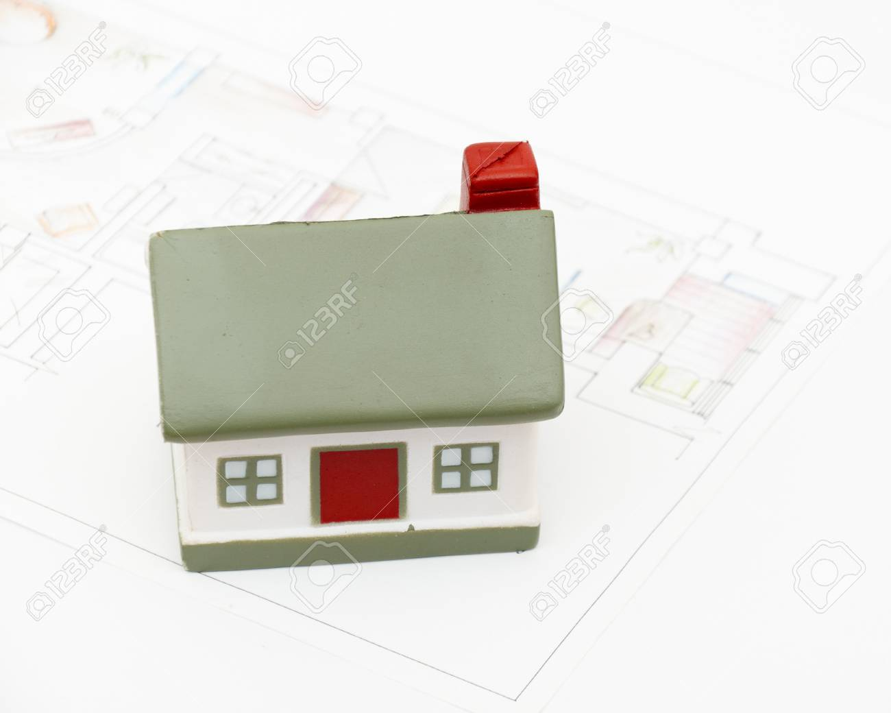 miniature house with various drafting items and plans. (i am author of this drawing) Stock Photo - 8540383