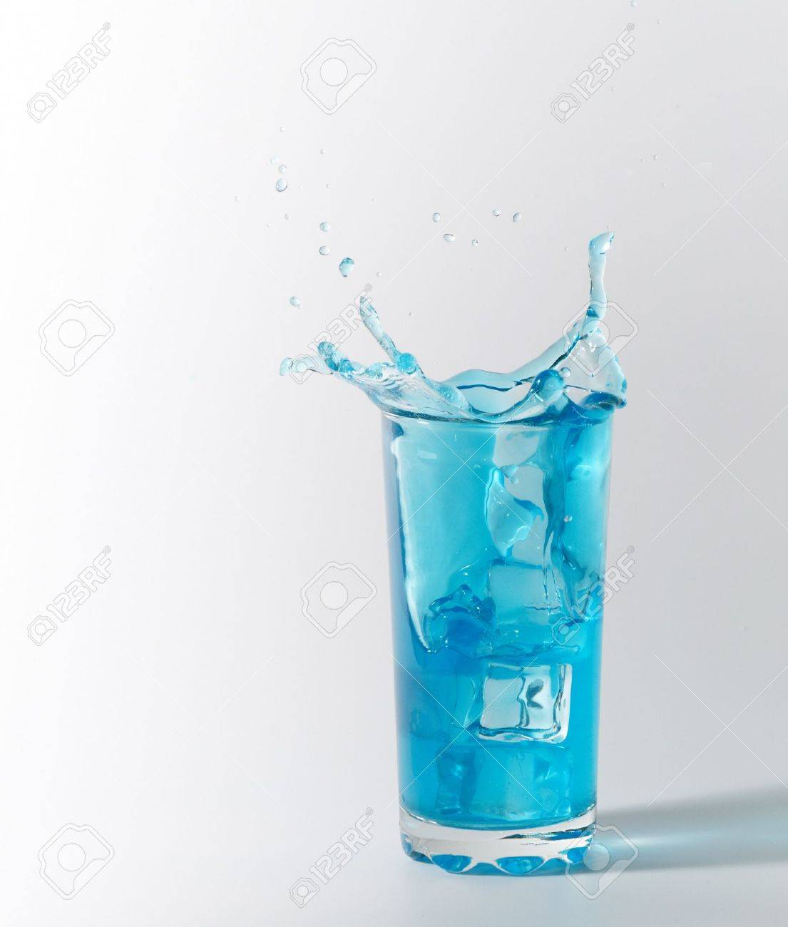 blue splash in glass from ice cube Stock Photo - 8918168