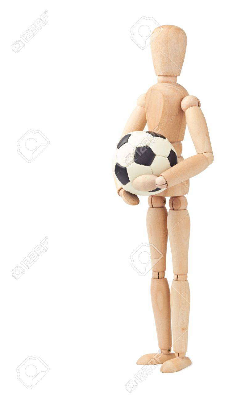 Wooden doll with soccer ball isolated on white Stock Photo - 9825596