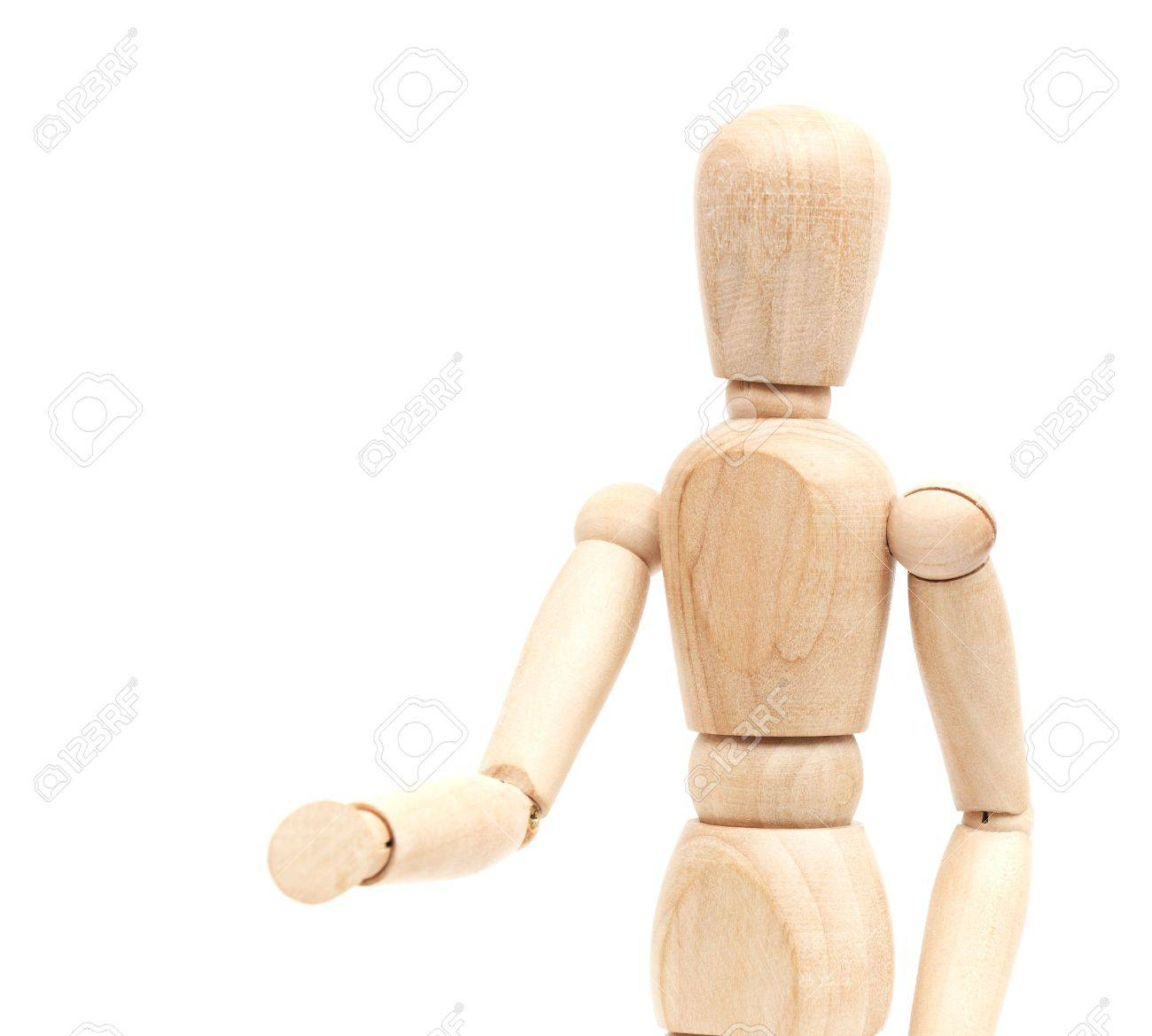 A wooden mannequin give a hand, greets. isolated on white Stock Photo - 10351901