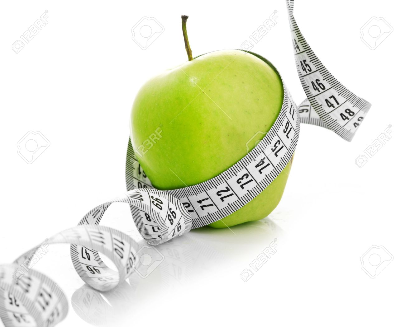 Measuring Tape Wrapped Around A Green Apple As A Symbol Of Diet