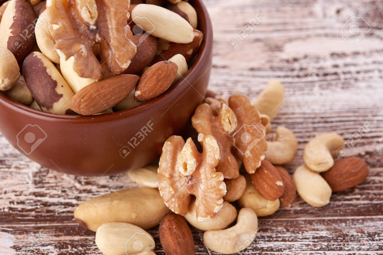 Mix nuts on wooden - 39444683