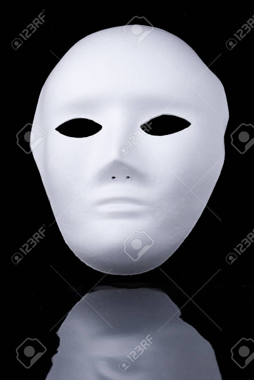 mysterious white face mask on black background stock photo, picture