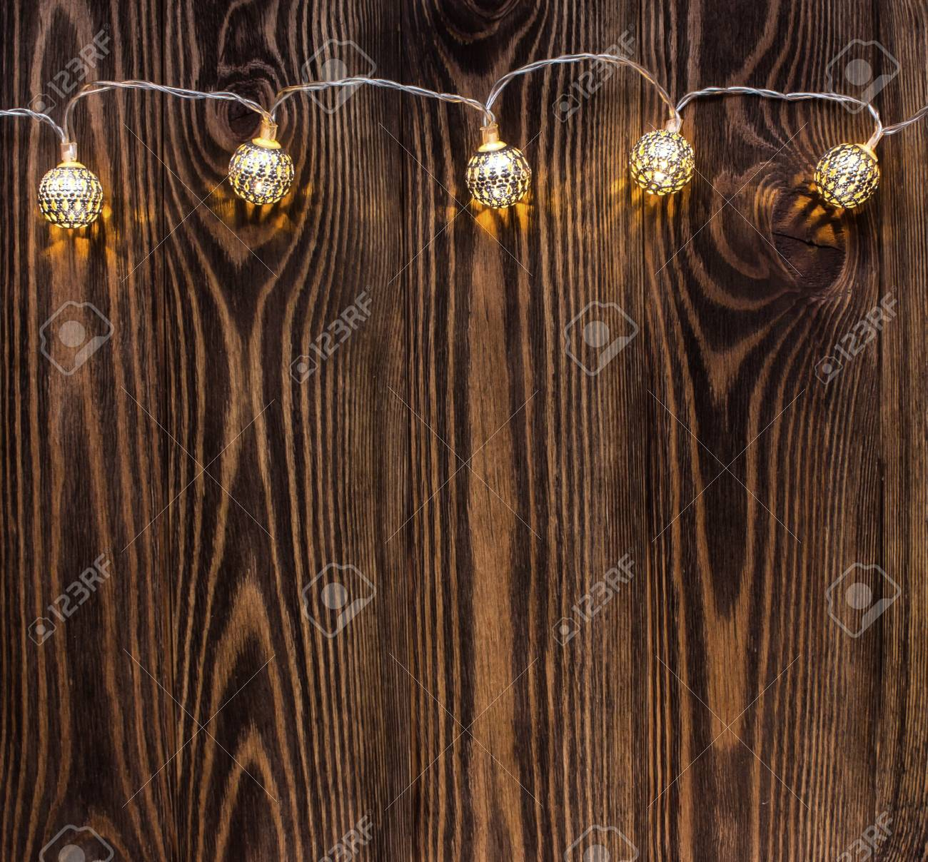Christmas Background With String Lights Vintage Garland On Wooden Planks Stock Photo