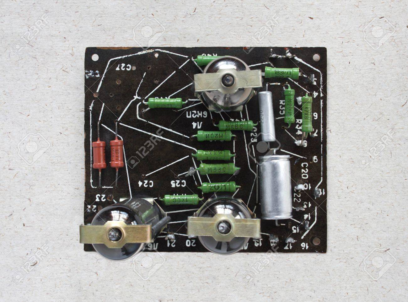Top view of valve amplifier on craft paper background