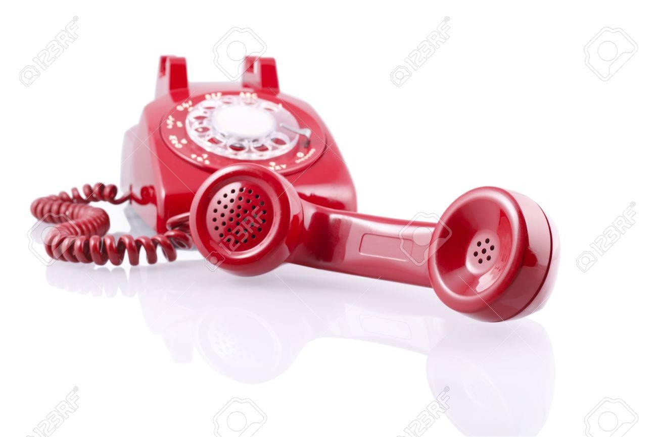白で隔離赤いビンテージ 1950 s 回転式電話 ロイヤリティーフリーフォト