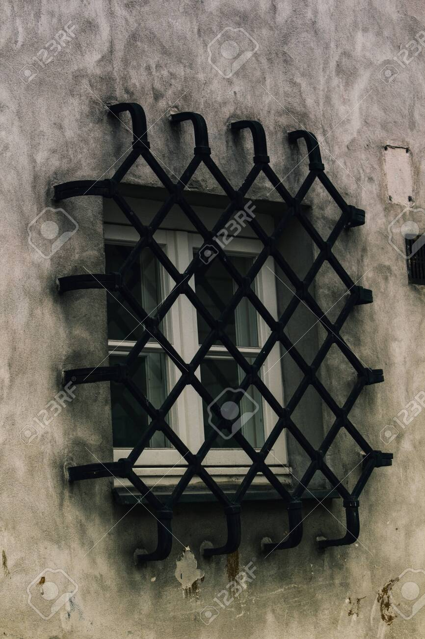 Close up of Diamond line design iron fences on a small window. - 136391820