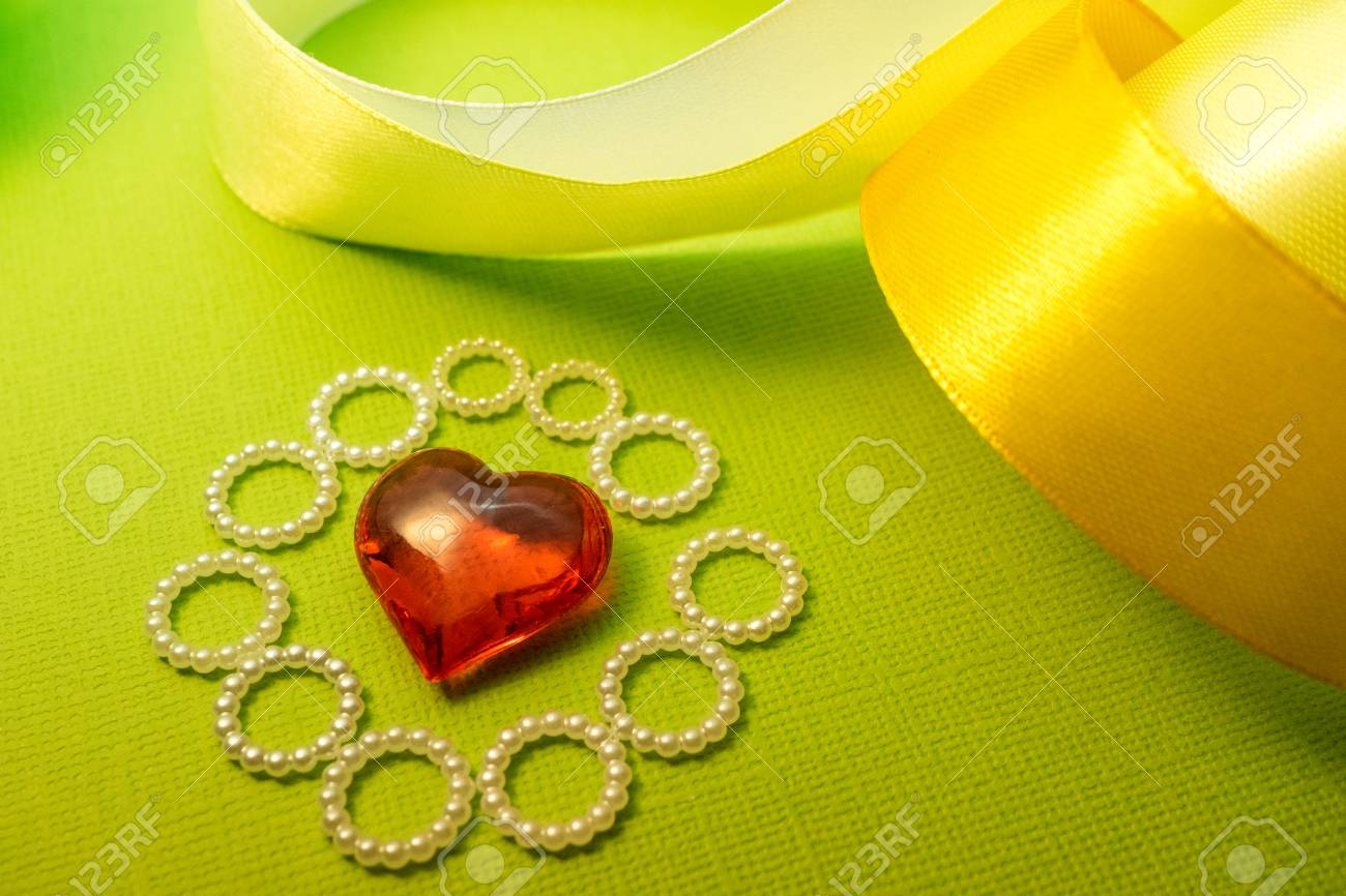 Heart And Ribbon On A Green Background Design For Love Messages