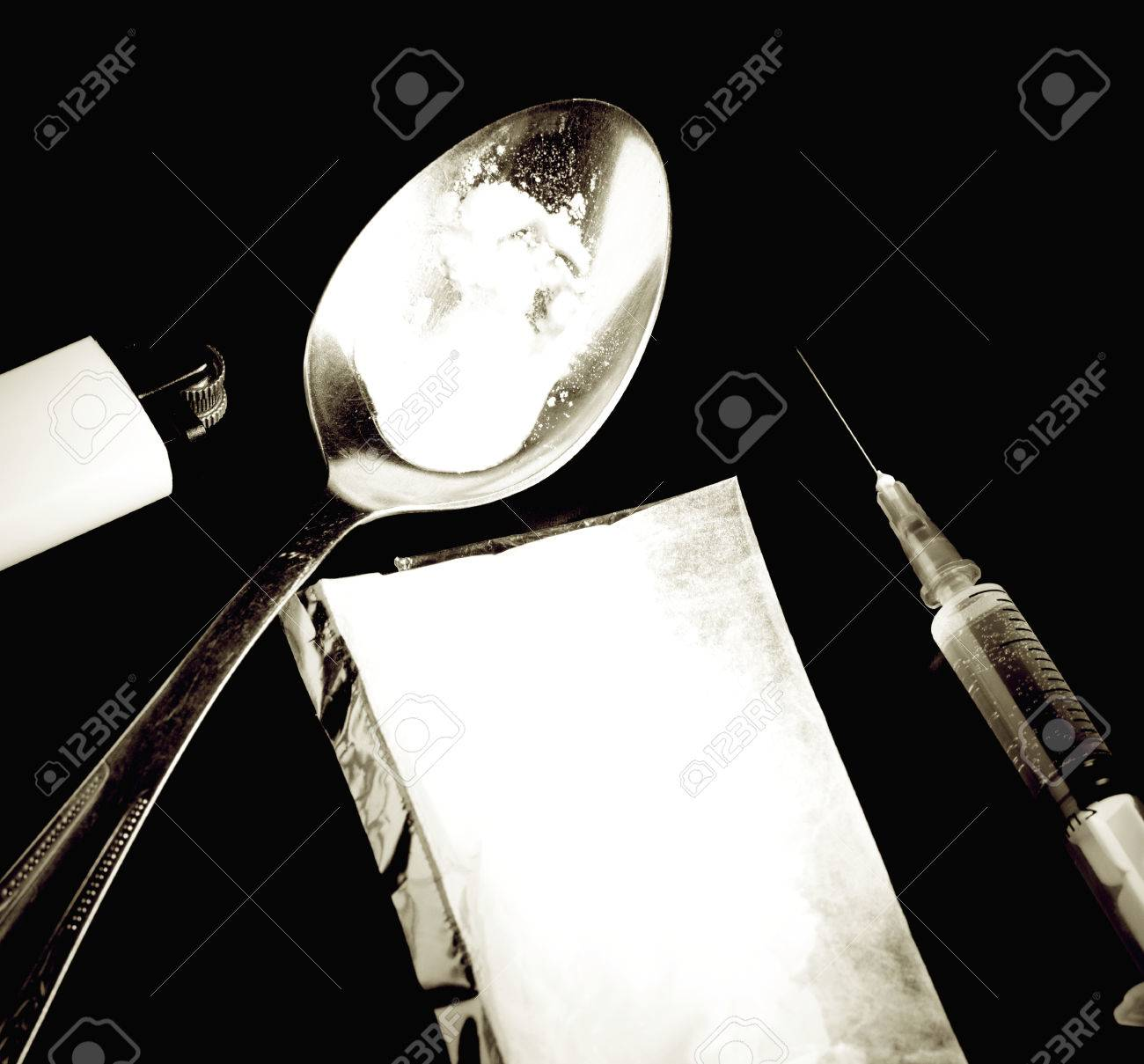 cooked heroin with syringe and cocaine sack Stock Photo - 26274584