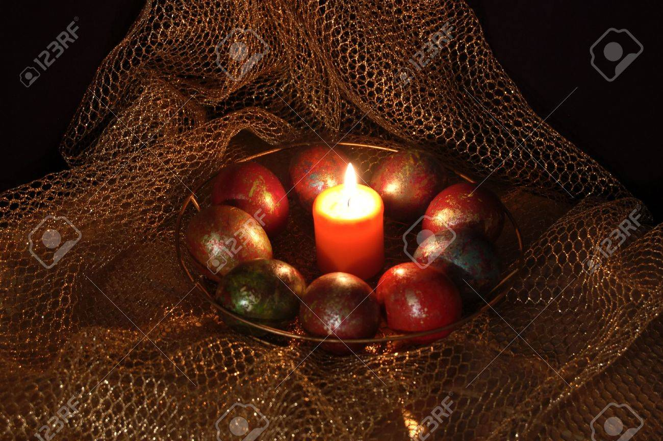 paschal egg in the nest of easter rabbit with candle Stock Photo - 2939510