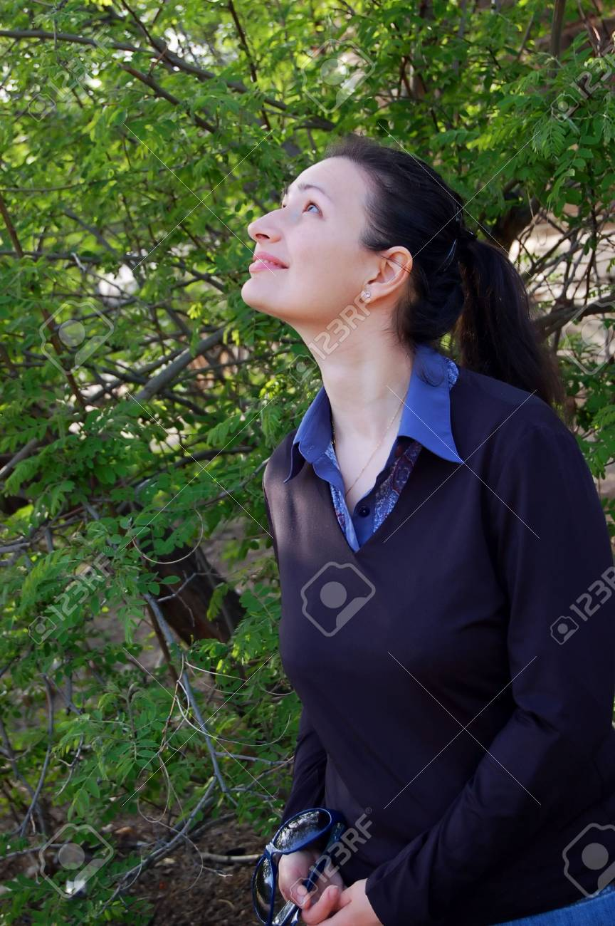 attractive young brunette and spring trees in the garden Stock Photo - 2986635