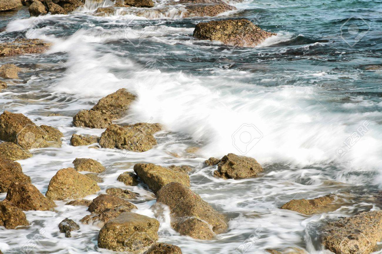 The rock on seashore with water and coming wave (HDR, long exposure) Stock Photo - 7616722