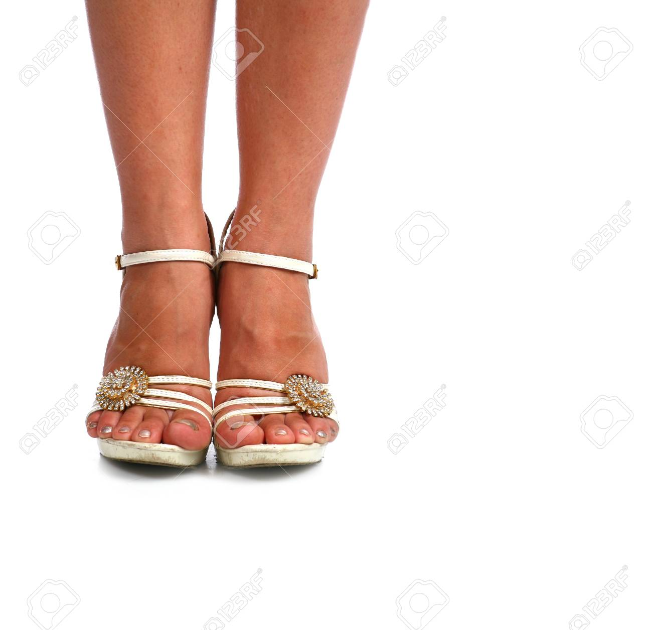 Woman legs with white high heel shoes over white Stock Photo - 9330838