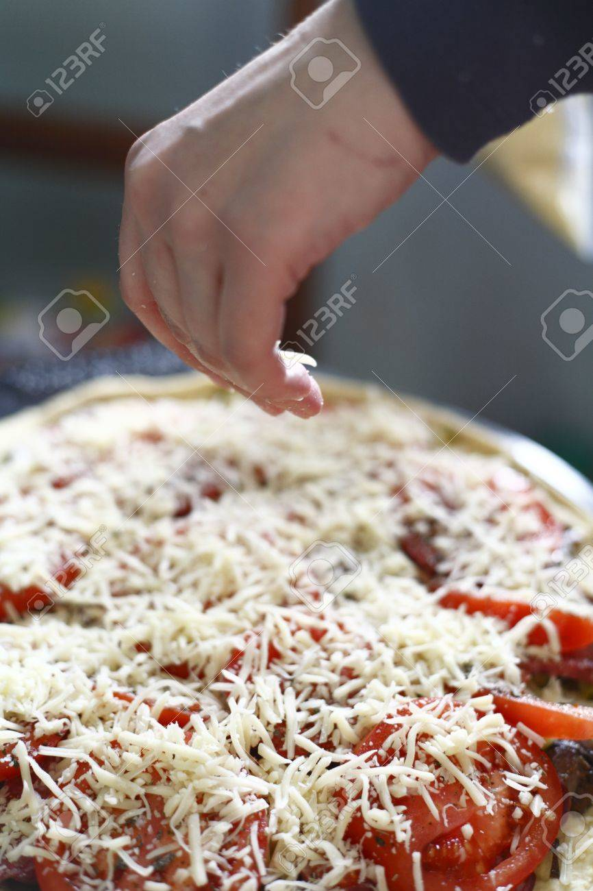 Uncooked homemade vegetarian pizza on kitchen counter Stock Photo - 13013222