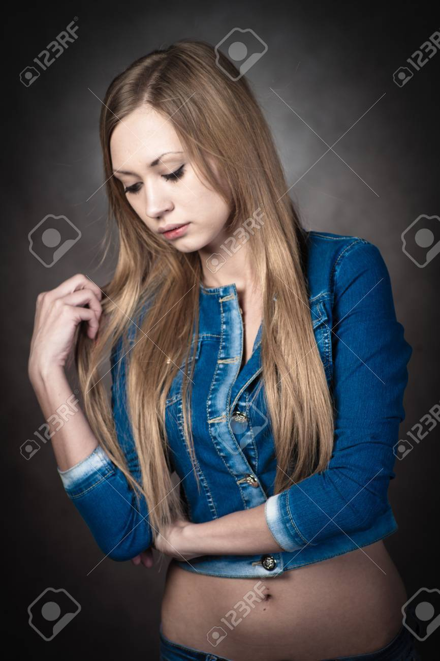 young blonde wearing jeans shorts and jacket Stock Photo - 13116381