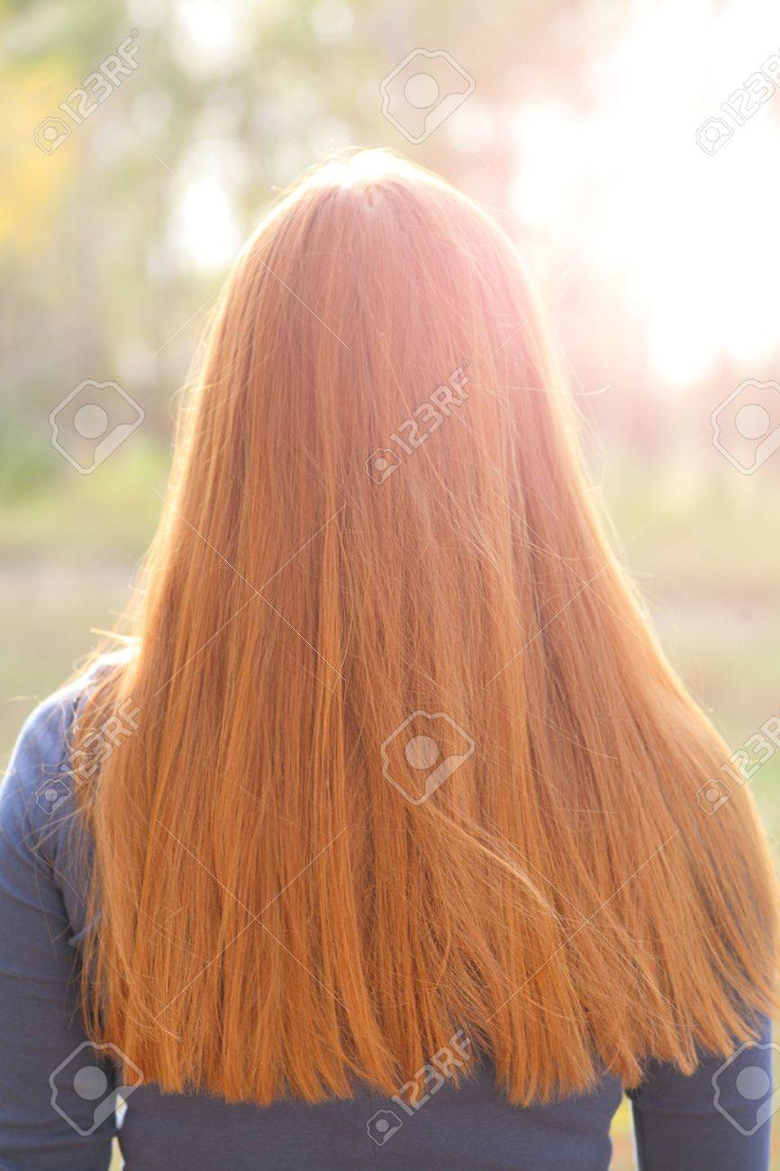 Gorgeous redhead girls hair from back. Outdoors, backlit Stock Photo - 15690178