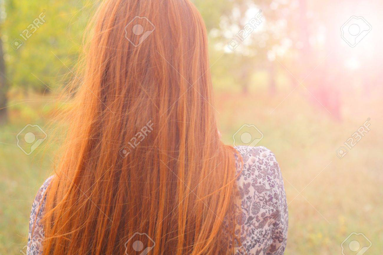 redhead from back backlit head and shoulders - 15785818