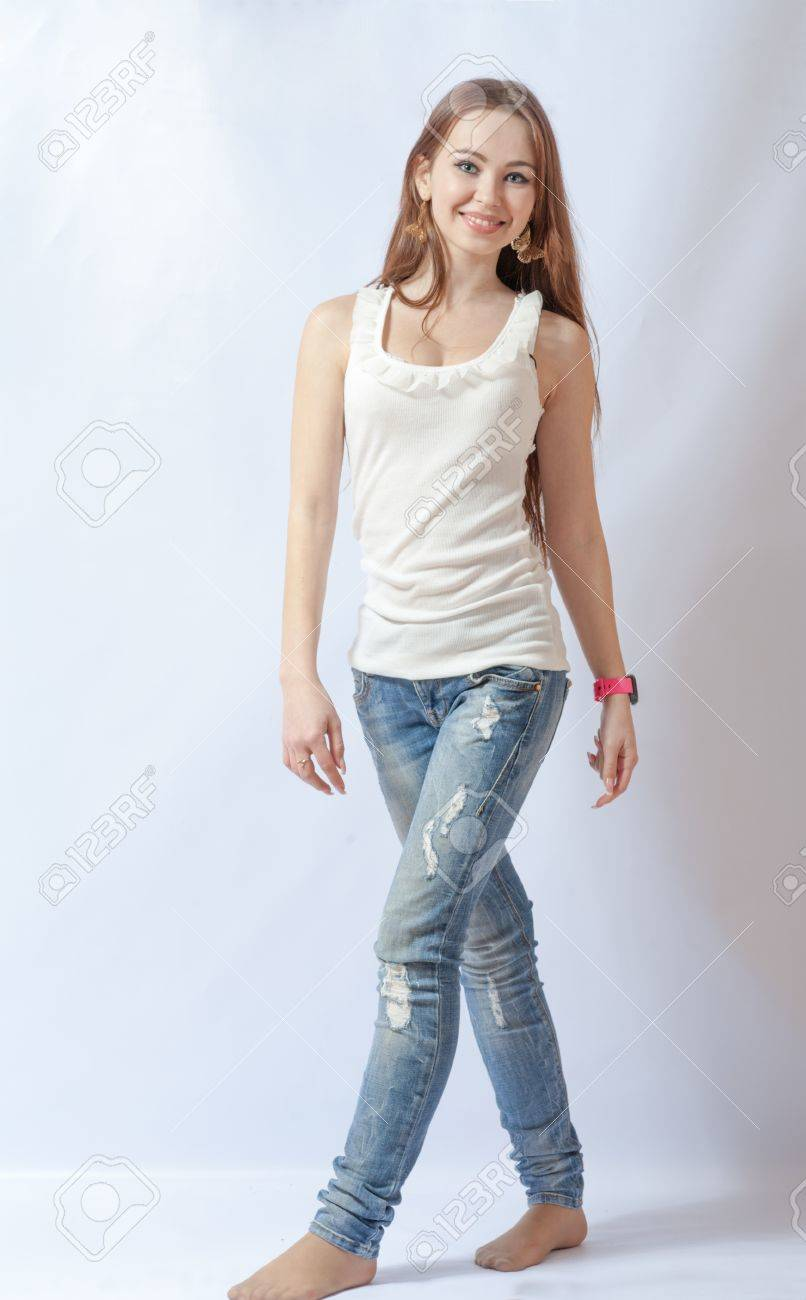 Full length portrait of a caucasian blond woman on gray background Stock Photo - 18260525