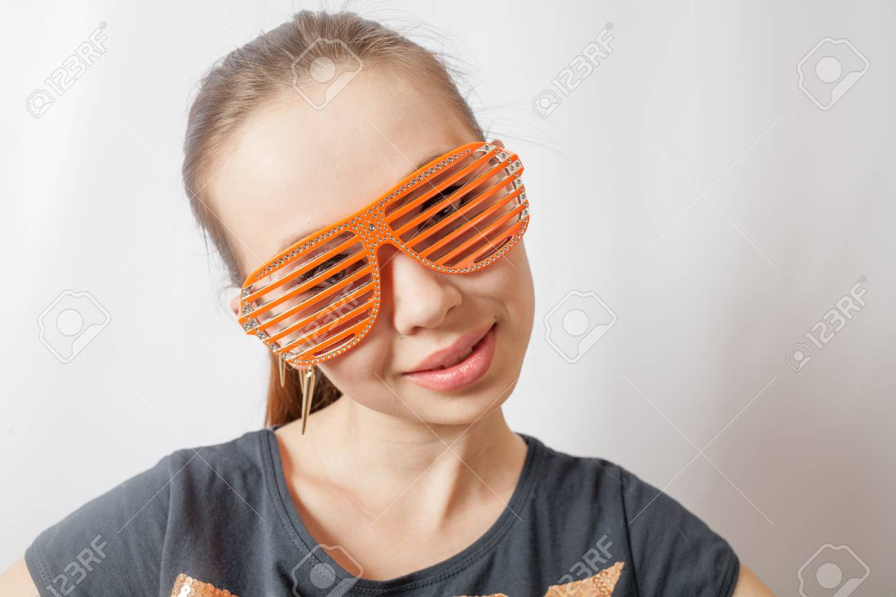 portrait of a beautiful young sexy woman wearing party sunglasses  Smiling face, having fun Stock Photo - 18629827