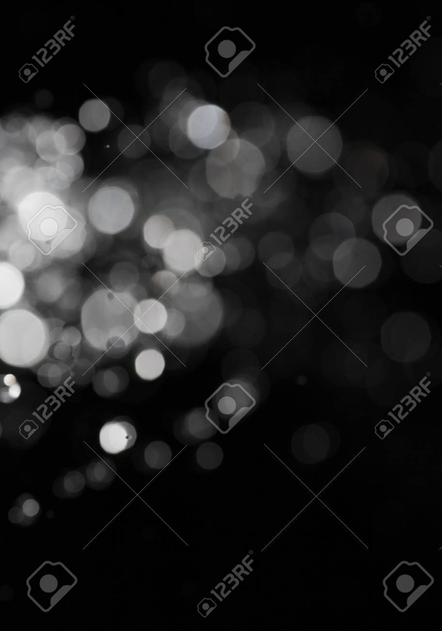 concentration of the bokeh lights on black background. A lot of copyspace Stock Photo - 22651037