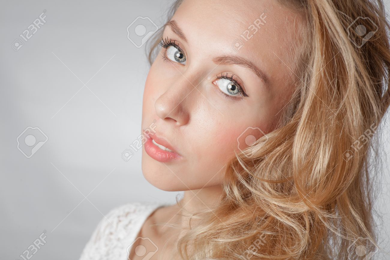 closeup of the face, blond women with long hair studio shot on white background Stock Photo - 23728839