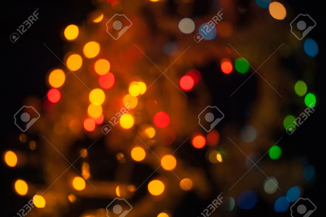 Xmas Wallpaper Of Blurred Spot Lights Cityscape At Night Stock Photo