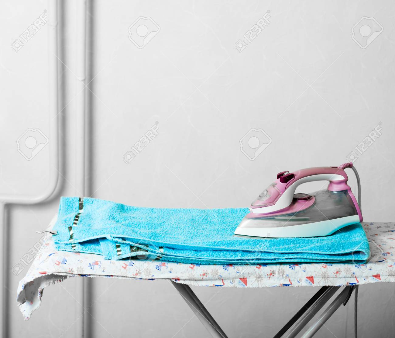 Pile of towels and smoothing-iron on the table and a lot of copyspace Stock Photo - 24106113