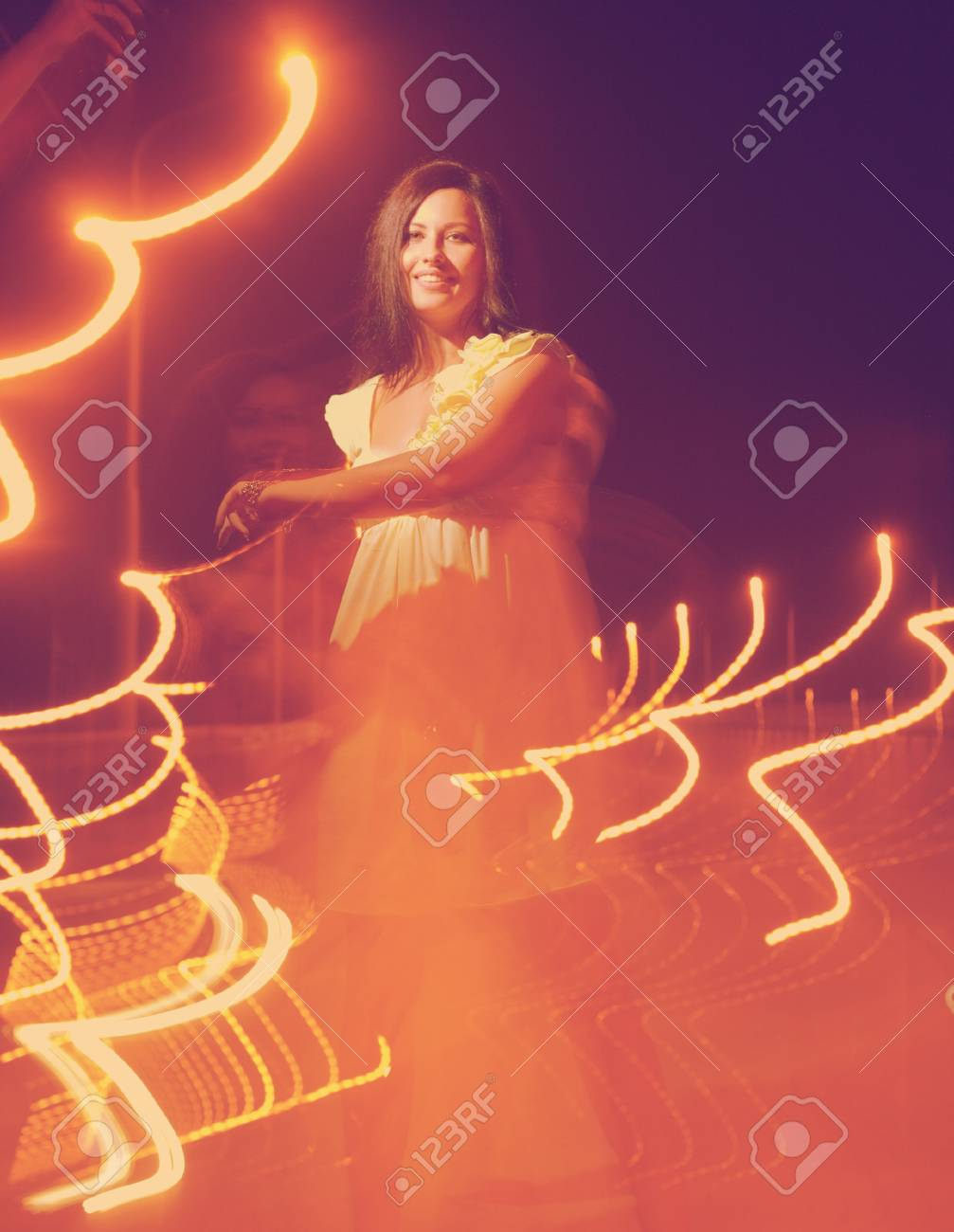 Toned image of dancing women  with lightpainting, long time exposure Stock Photo - 28428372