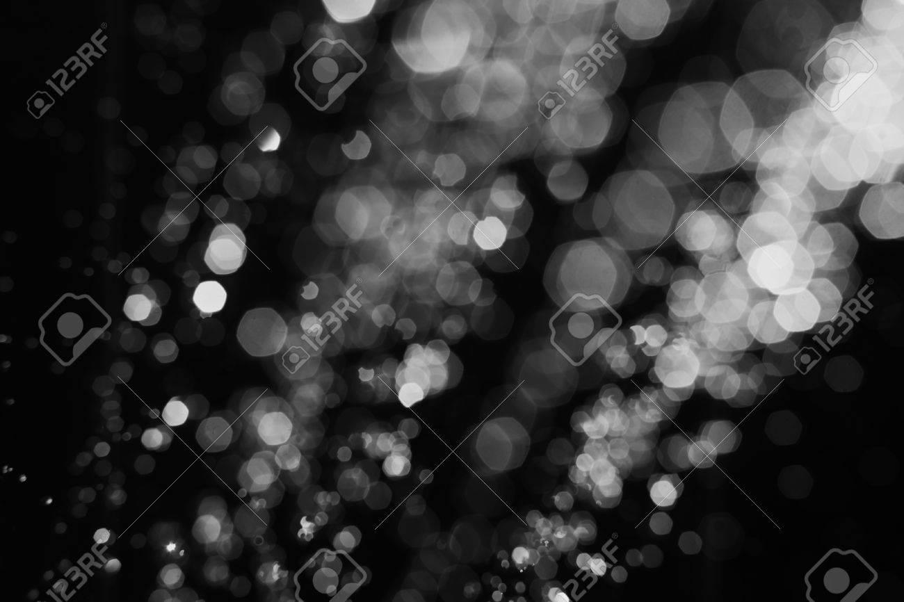 A background image hover - Defocused Water Drops Fly Hover In The Air On Black Background Blurred Bokeh Abstract Image
