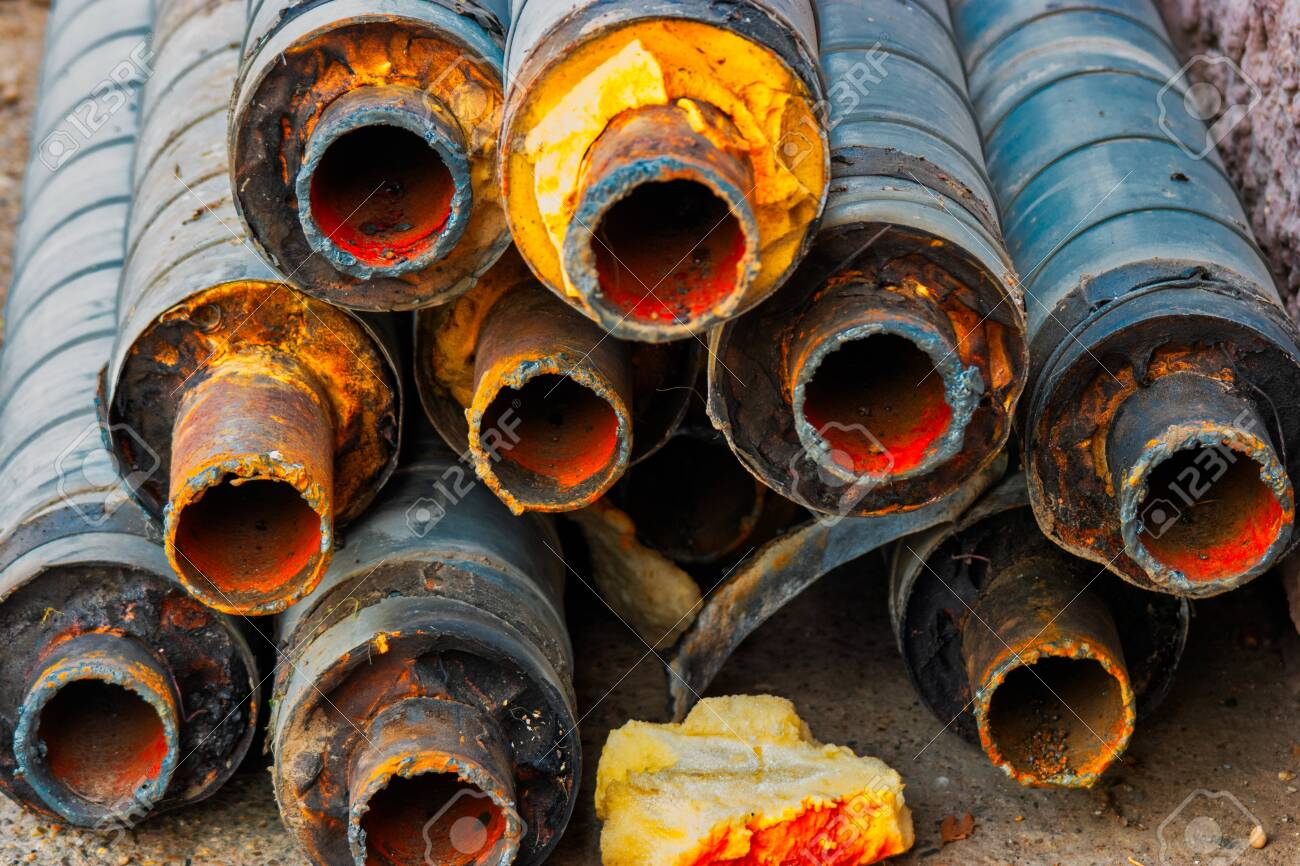 Many corroded rusty pipes with footprint of welding on side - 122837321