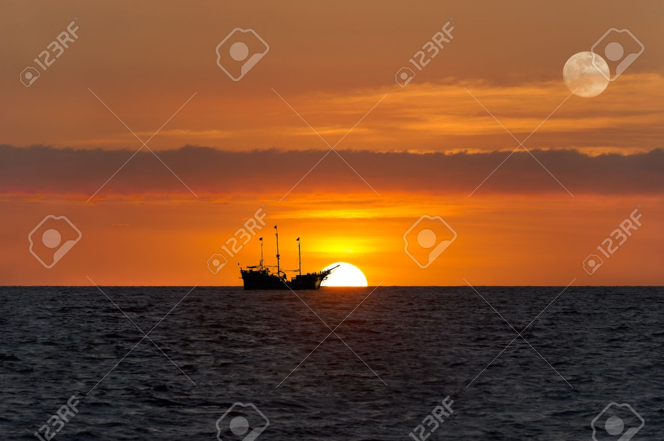 Ship Silhouette Sunset Is An Old Wooden Pirate Sitting At Sea With The Full Moon
