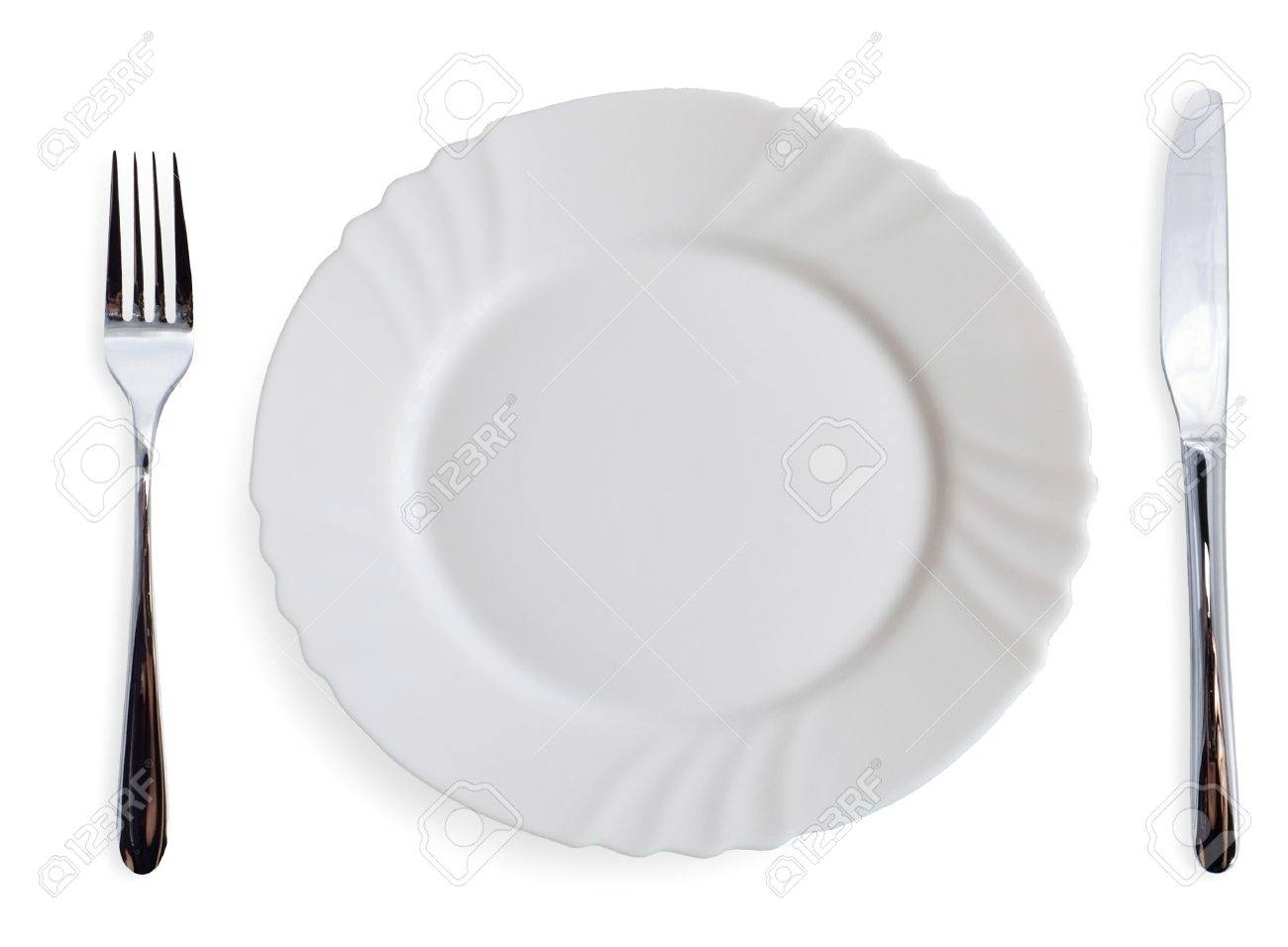 Stock Photo   White Dining Plates And Silverware On White Background