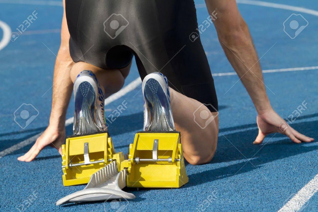 Male runner waits for his start - 12841742