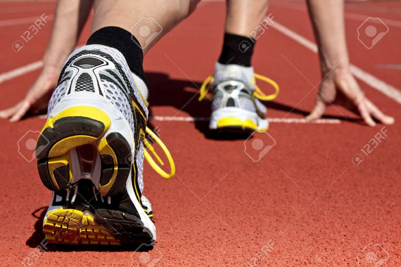 Runner in stadium waits for his start - 13147586