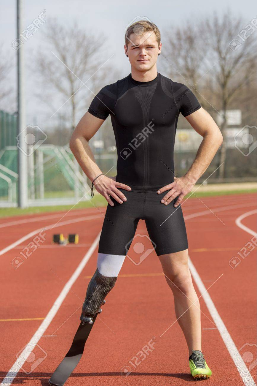 Athlete with handicap stands on a race track - 19425960