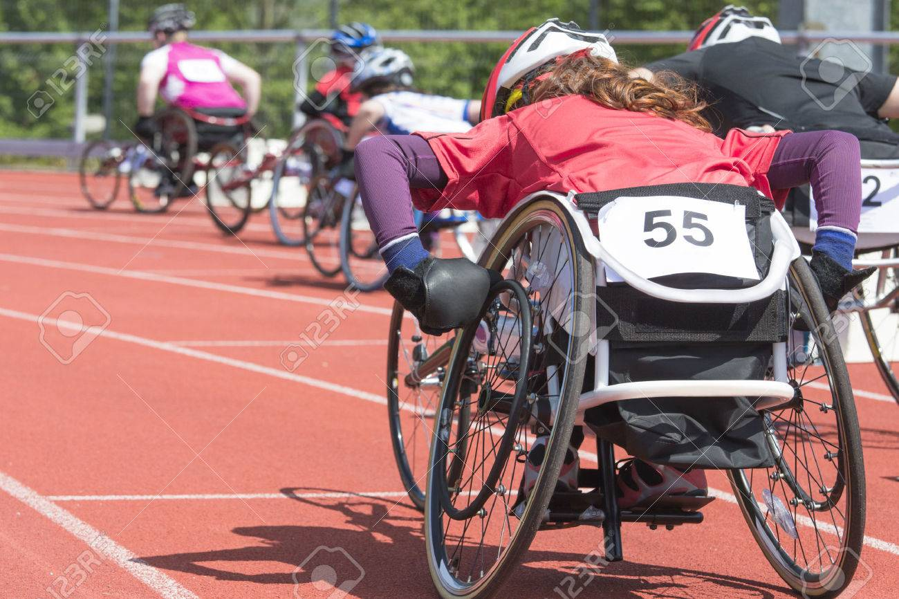 Athletes at a wheelchair race in a stadium - 29280551