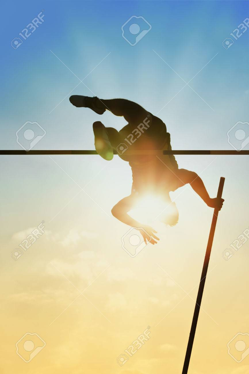 Pole vault over the bar with back light - 30891163