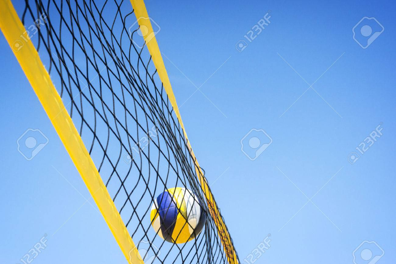 Beach volleyball caught in the net. - 40818734