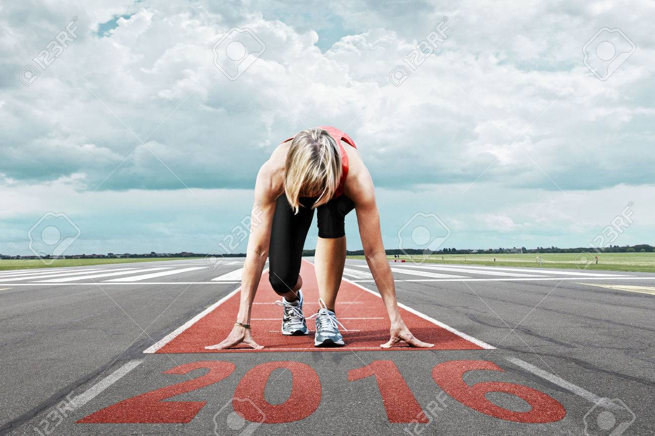 Female runner waits for the start on an airport runway. In the foreground perspective view of the date 2016. - 46479902