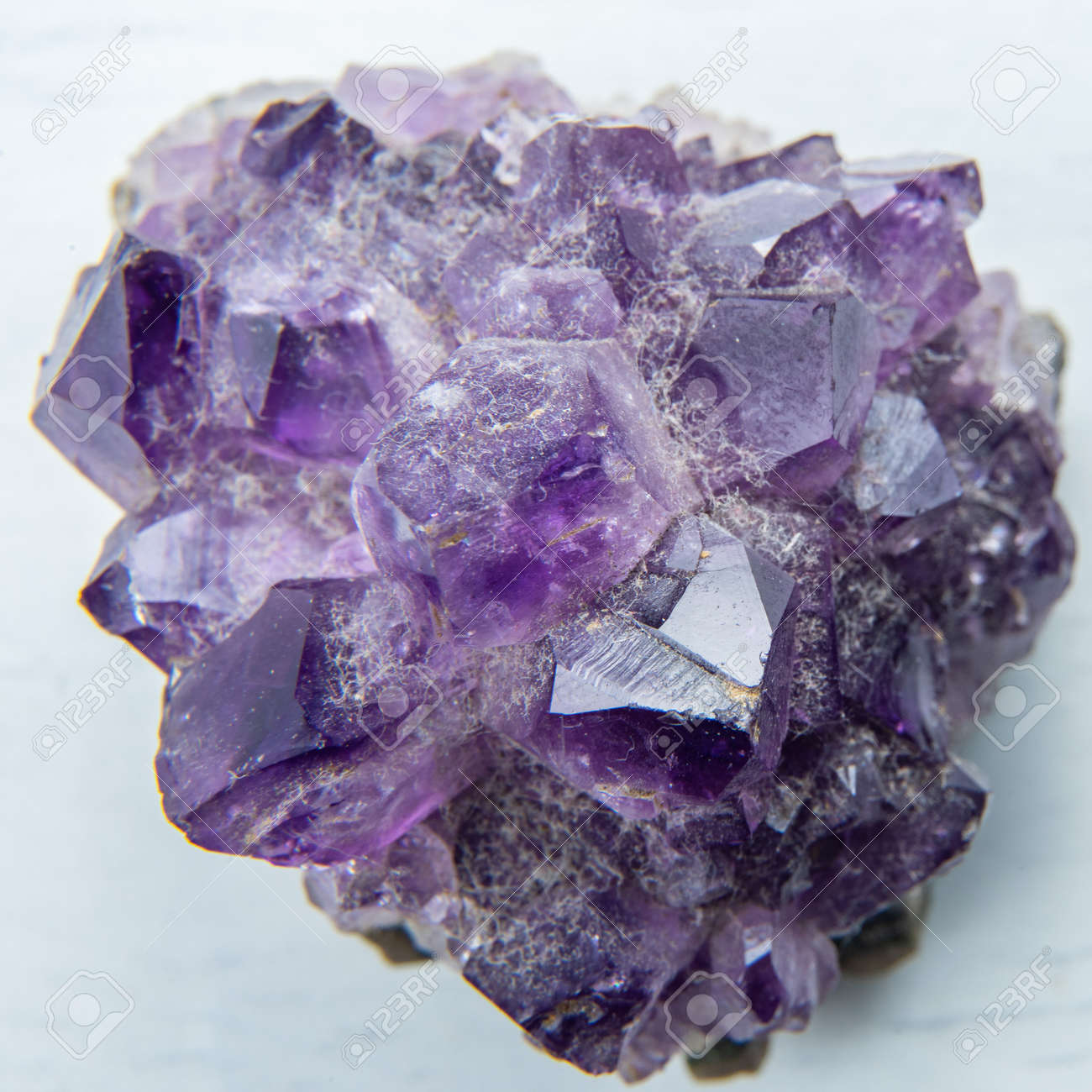 Amethyst mineral gemstone, macro view on a white background - 146004212