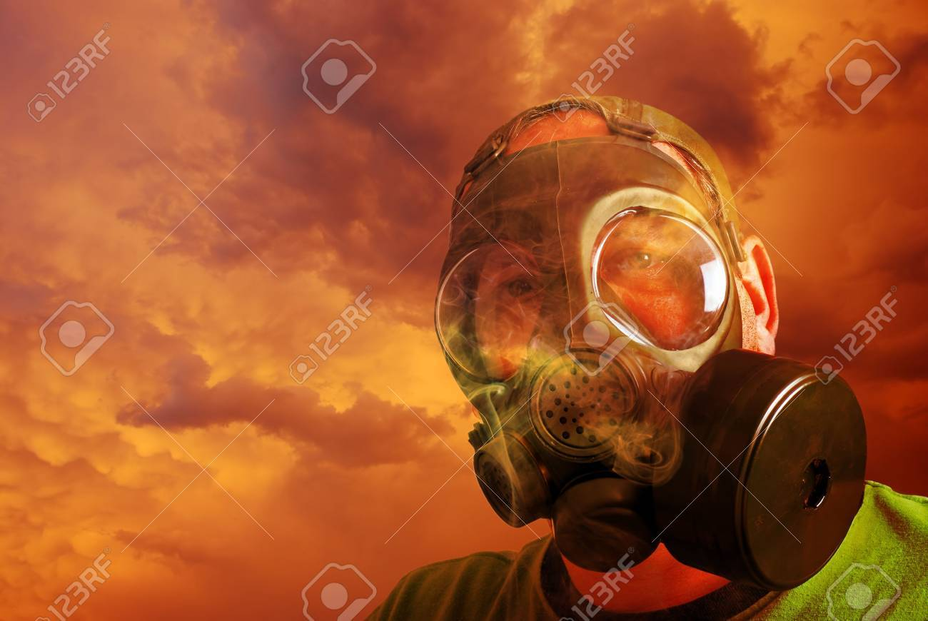 man protecting himself with gas mask from clouds and smoke Stock Photo - 5486118