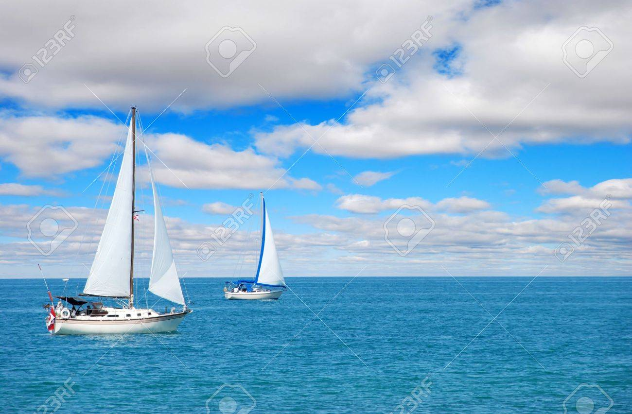 sail boating on blue water - 5576229