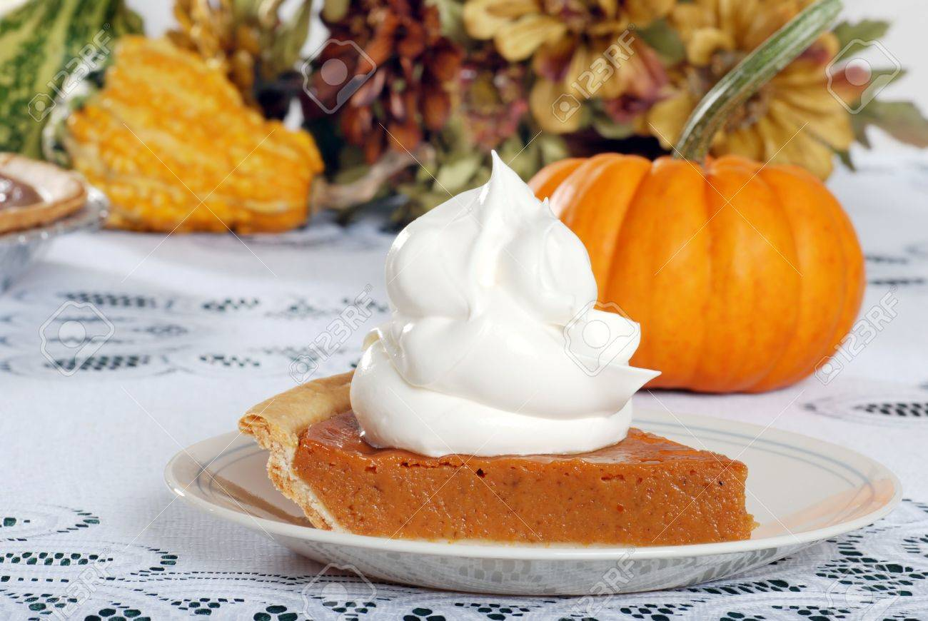 whipped cream loaded on pumpkin pie Stock Photo - 5698035